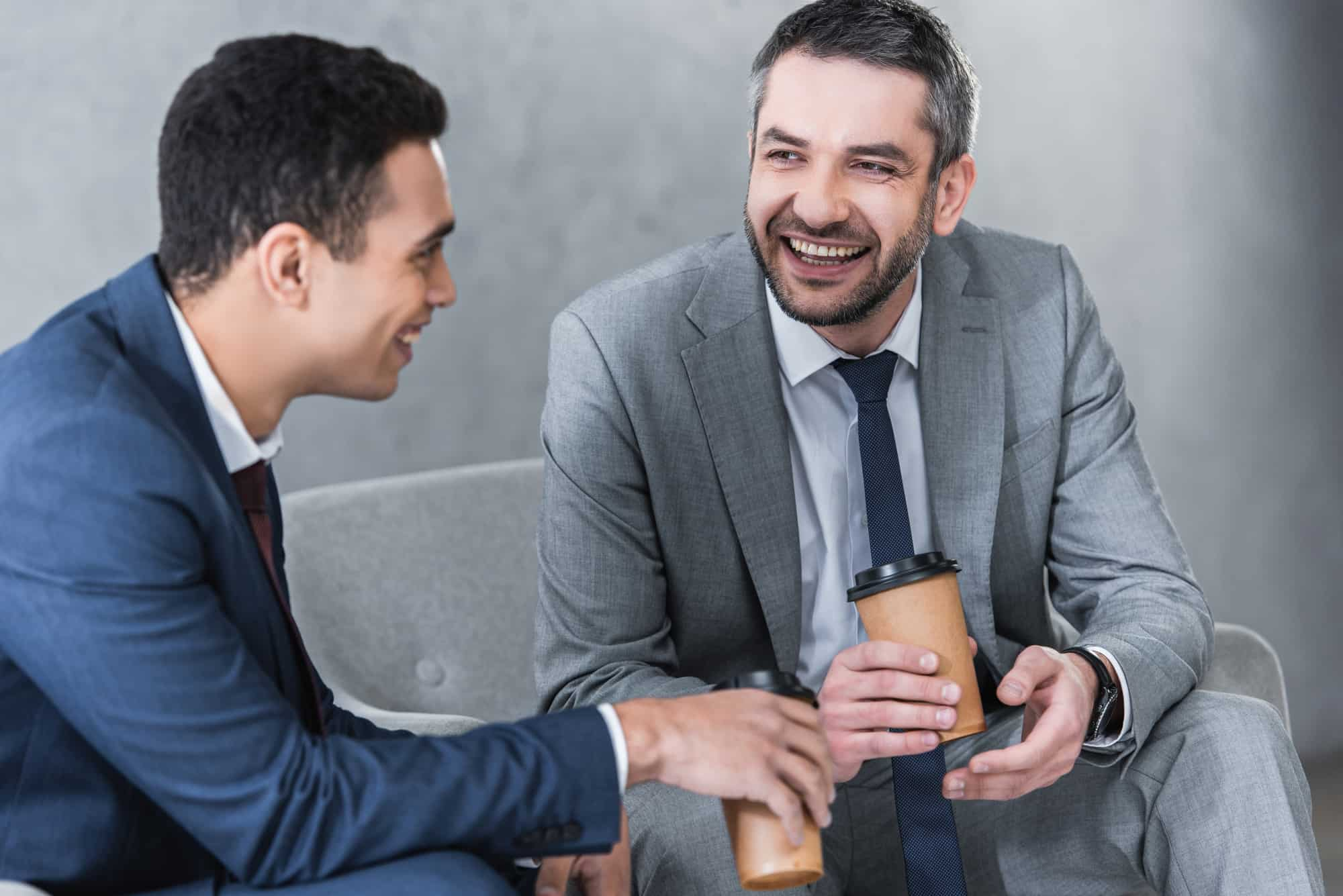 How can a retail executive benefit from coaching and mentoring?